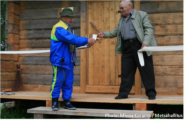 Pauli Hietala and Eero Manninen opening a reconstructed building in an old Finnish settlement in Paanajärvi National Park, Russia