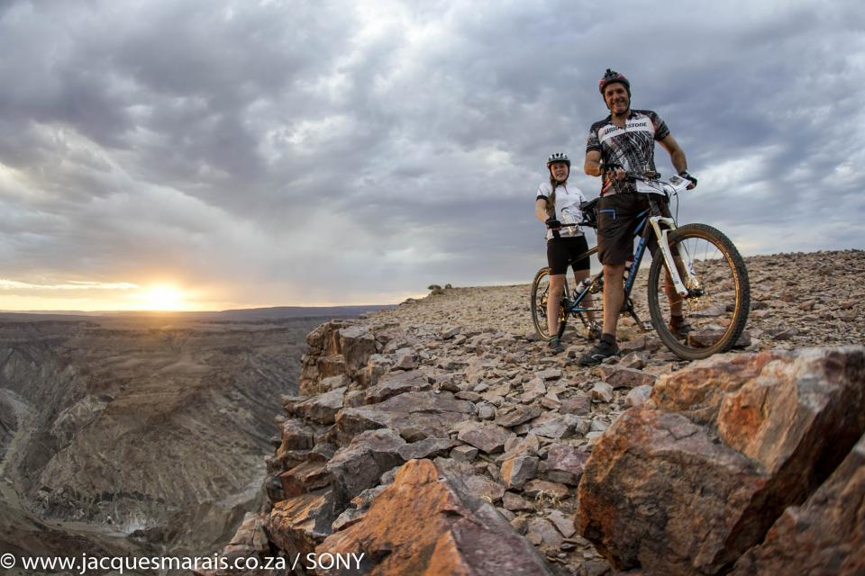 Cycling along the edge of the Fish River Canyon on Day 1 of the Desert Knights Mountainbike Tour, photo by Jacques Marais